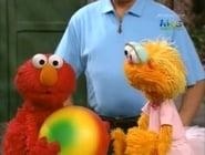 Elmo and Zoe Claim a Ball