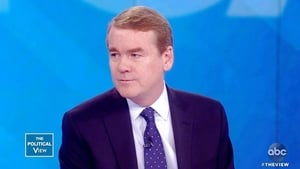 Michael Bennet and Katie Couric
