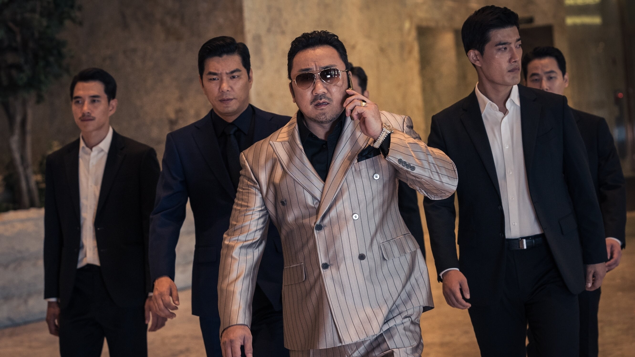 El gángster, el policía y el asesino