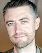 Sean Gunn isMarty Espenscheid