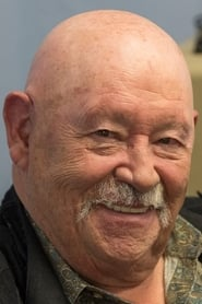 Barry Corbin isGeorge