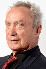 Udo Kier isMan in the Coat