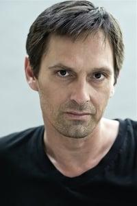 Patrick Hauthier as L'Homme de la Gare in Give Me Your Hand