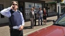 Gus entra en un banco