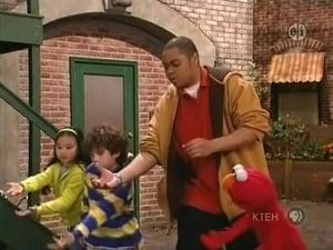Backdrop image for Chris Teaches Elmo How to Bowl