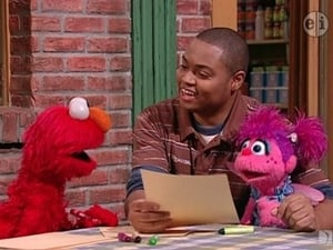Backdrop image for Chris Helps Elmo Write a Letter