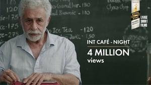 English movie from 2014: INT. CAFÉ – NIGHT