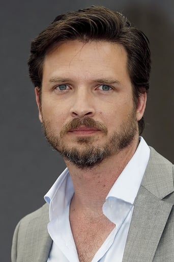 Image of Aden Young