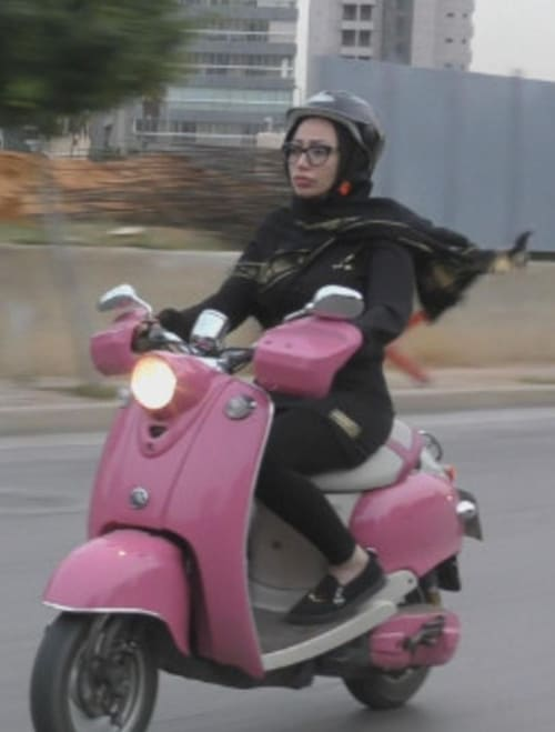 Zeinab on the Scooter